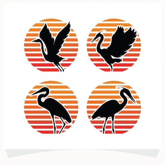 Set of bird silhouettes against stripped circle