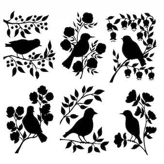Set of bird silhouettes and flowers