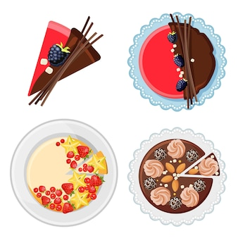 Set of birthday cakes with fresh organic fruits, chocolate sticks, sugar and candies on plate top