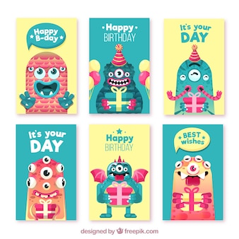 Set of birthday cards with funny monsters