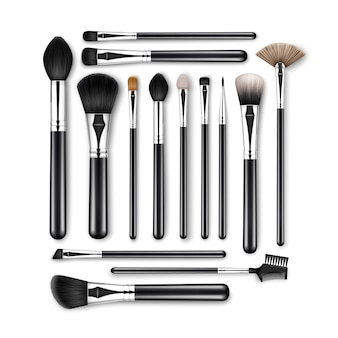 Set of black clean professional makeup concealer powder blush eye shadow brow brushes with black handles isolated