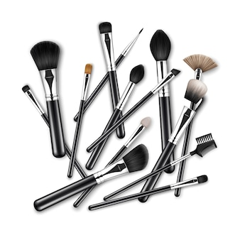 Set of black clean professional makeup concealer powder blush eye shadow brow brushes with black handles scattered chaotically isolated