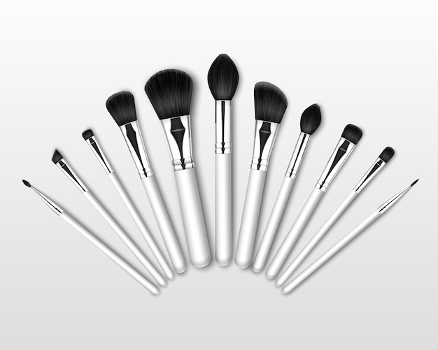 Set of black clean professional makeup concealer powder blush eye shadow brow brushes with white handles isolated