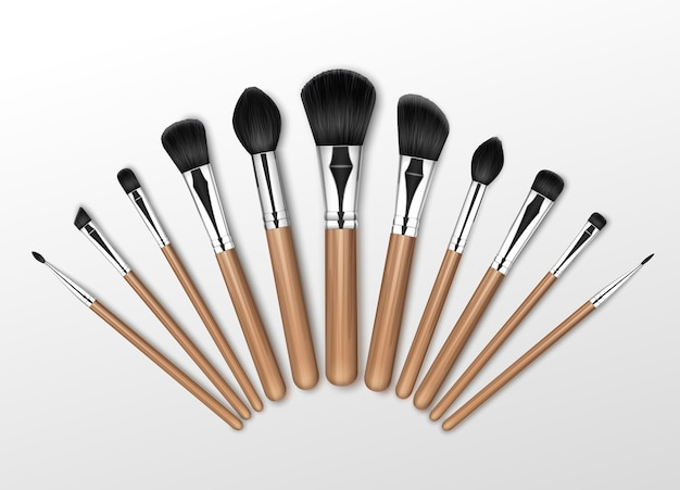 Set of black clean professional makeup concealer powder blush eye shadow brow brushes with wooden handles isolated