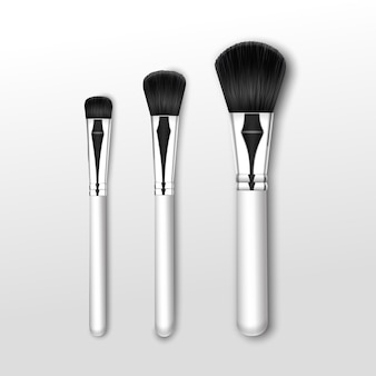Set of black clean professional makeup powder round large medium small brush with white handle isolated on white background