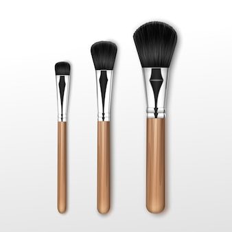 Set of black clean professional makeup powder round large medium small brush with wooden handle isolated on white background