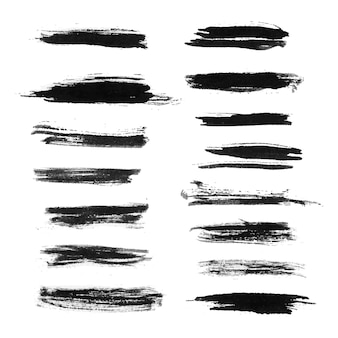Set of black grunge brush strokes isolated on white background