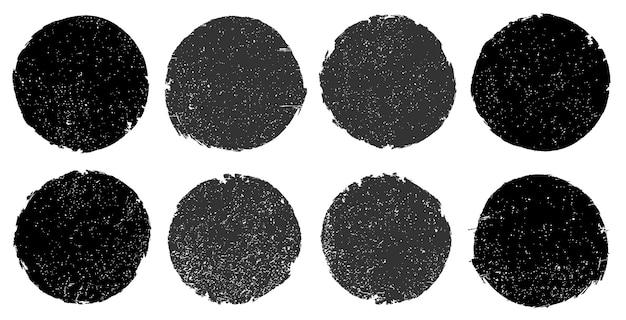 Set of black grunge round stamps