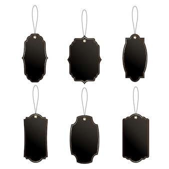 Set of black price or luggage tags of vintage shapes with rope.