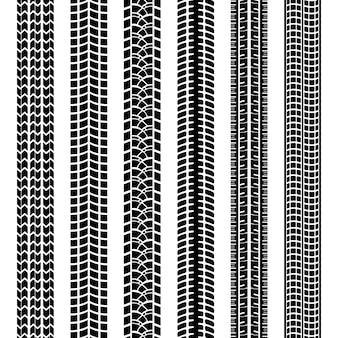 Set di tracce di pneumatici in bianco e nero o stampe lasciate nel fango sporco o nella neve dai battistrada sui pneumatici dei modelli vettoriali senza soluzione di continuità del veicolo o della macchina