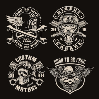 Set of black and white vintage biker emblems on dark