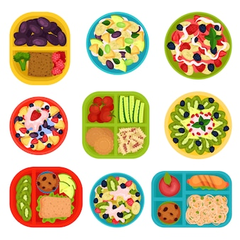Set of bowls with fruit salads and lunch boxes with food. healthy eating. tasty dishes for breakfast