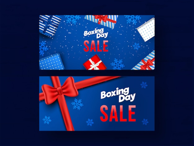 Set of boxing day sale banner set with top view gift boxes and snowflakes decorated on blue