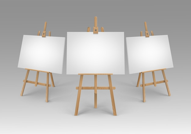 Set of brown sienna wooden easels with empty canvases