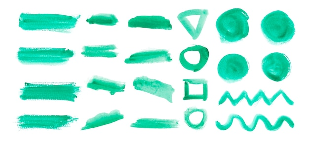 Set of brushed elements in green watercolor