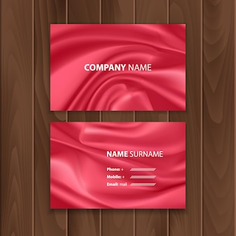 Set of business cards on a wooden substrate. business cards decorated with red drapery