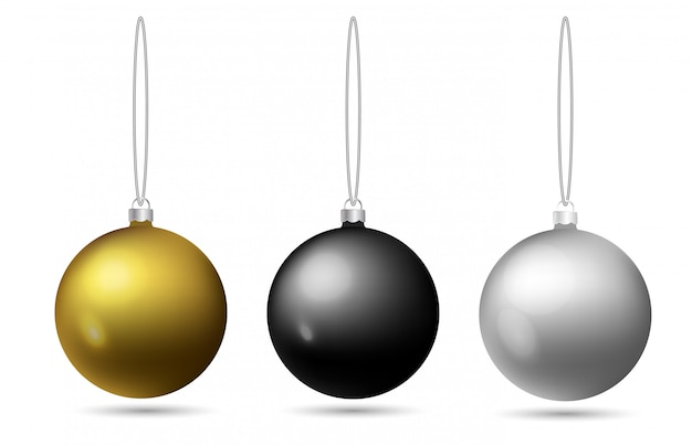 Set of christmas balls hanging on a rope. black, golden, silver toy on the christmas tree.