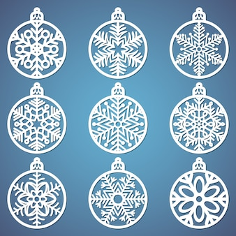 Set of christmas balls with a snowflake cut out of paper