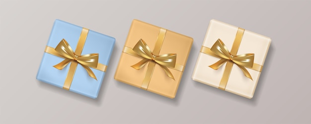 Set of christmas realistic gift box with golden bow