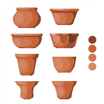 Set of clay pots on white