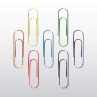 Set of colored paper clips  on white background