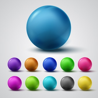 Set of colorful glossy spheres isolated on grey.