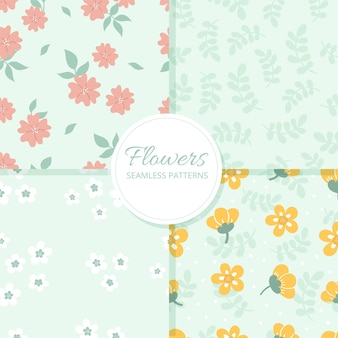 Set of cute delicate vector seamless patterns with flowers on a blue background