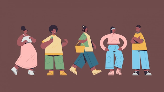さまざまなポーズで立っているカジュアルなトレンディな服アフリカ系アメリカ人の男性女性でかわいい人を設定します