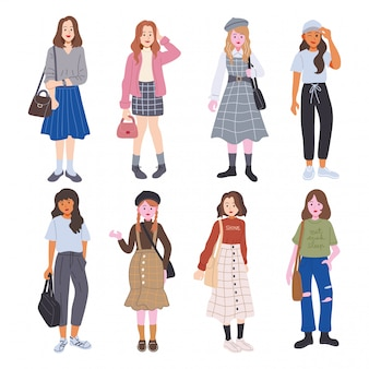 Set of cute young woman dressed in trendy clothes