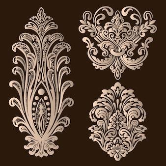 Insieme di elementi ornamentali damascati.