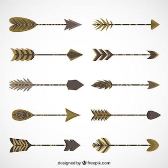 Insieme delle frecce decorative in tonalità marrone
