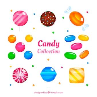 Set di deliziose caramelle in stile piatto