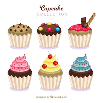 Set of delicious cupcakes in flat style