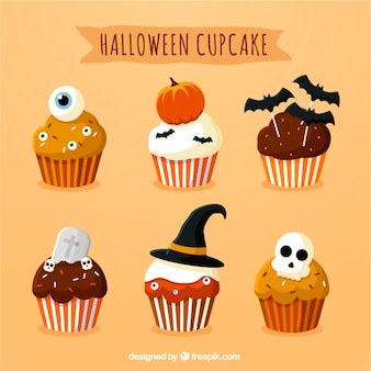 Set of delicious cupcakes with halloween decoration