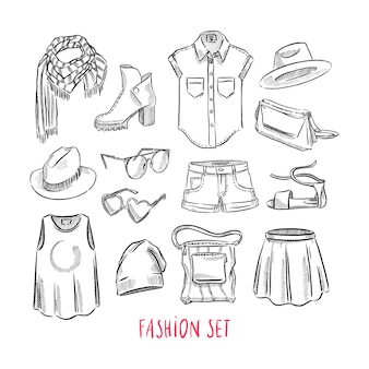 Set of different female clothing and accessories. hand-drawn