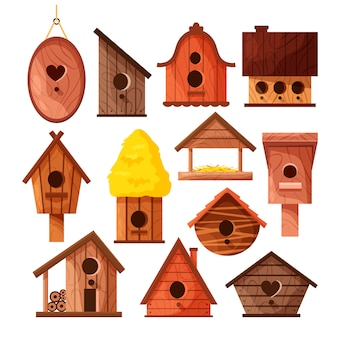 Set of different wooden handmade bird houses isolated on white background.