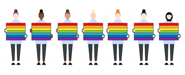 Set of diverse race female characters holding a rainbow flag