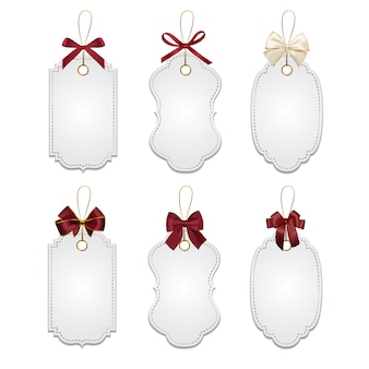 Set of elegant tags with red bows