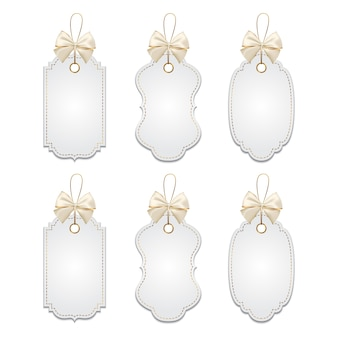 Set of elegant tags with silver and golden bows
