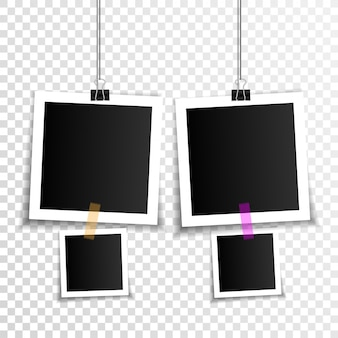 Set of empty photo frames with binder clips and adhesive tape
