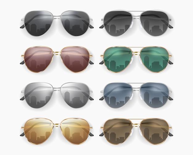 Set of fashionable sunglasses on white background