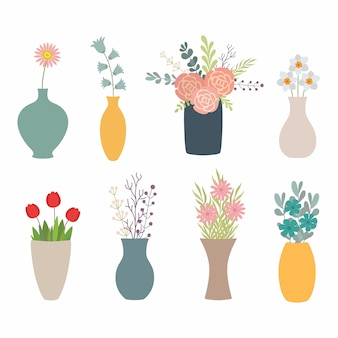 Set of flowers in vases on white
