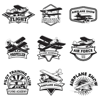 Set of flying academy emblems. vintage airplanes.  elements for logo, label, emblem, sign.  illustration.