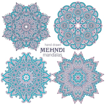 Set of four abstract vector round lace design mandalas, decorative elements.