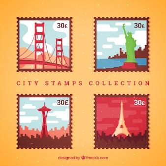 Set di quattro francobolli colorati con diverse città