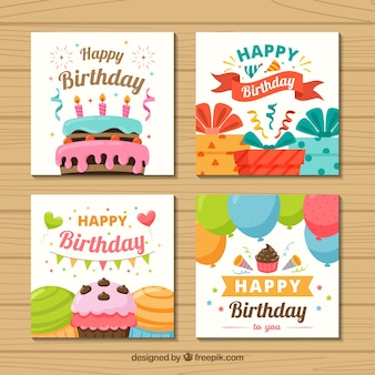 Set of four colourful birthday cards in flat design