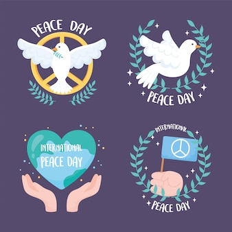 Set of four designs for the international day of peace vector illustration