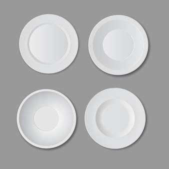 Set of four empty white plates isolated on gray background, top view