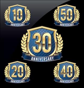 Set of four luxury anniversary badges Premium Vector