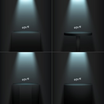 Set of four realistic podiums on a dark room.